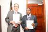 The VC Prof. P. Mbithi with PI of HORN Prof. Mathew Baylis with Signed Documents